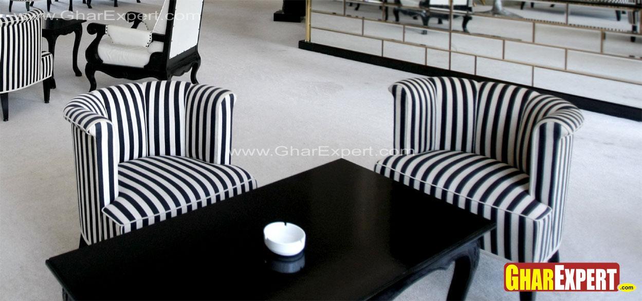 Black and white striped sofas