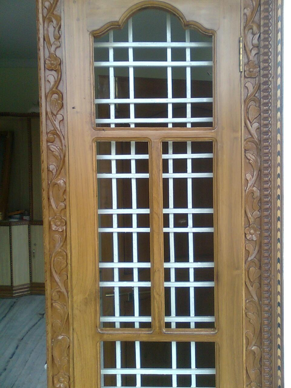 Door design with grills gharexpert for Wooden main door design catalogue