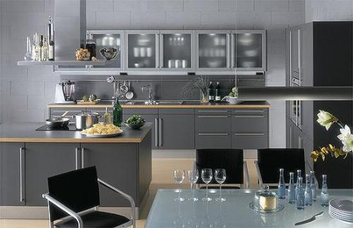 Modular Kitchen Design With Cook Top And Hood At The Center Of The Kitchen Gharexpert