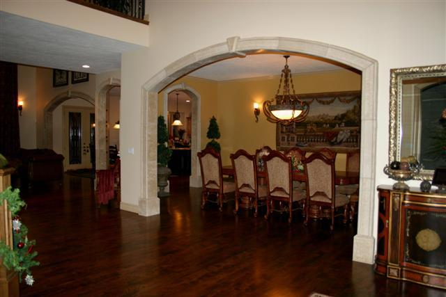 Arch design in lobby with wooden flooring and traditional dining furniture gharexpert Home arch design