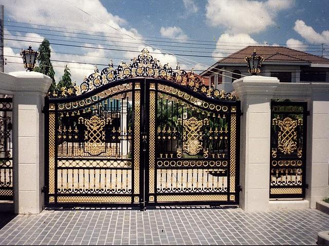 Main entrance gate design gharexpert for Wall gate design homes