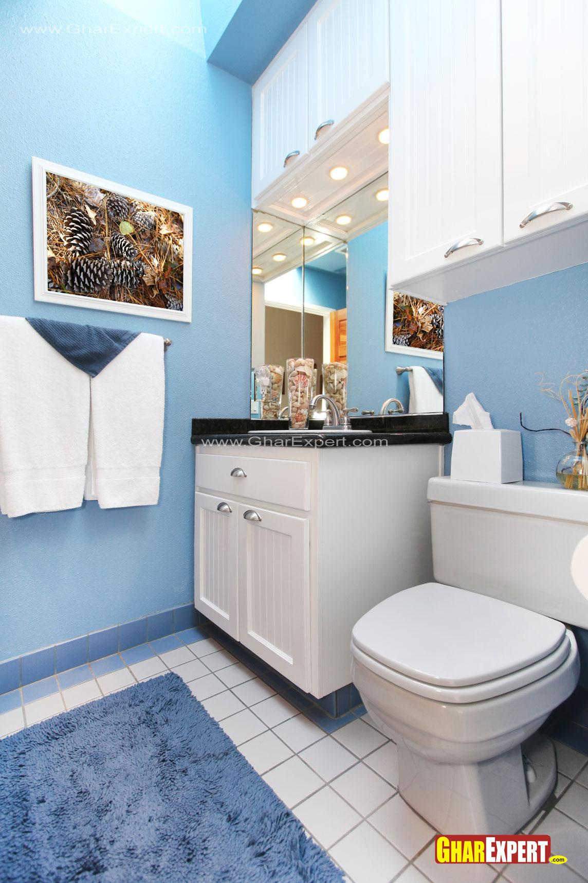 White vanity in blue colored b....