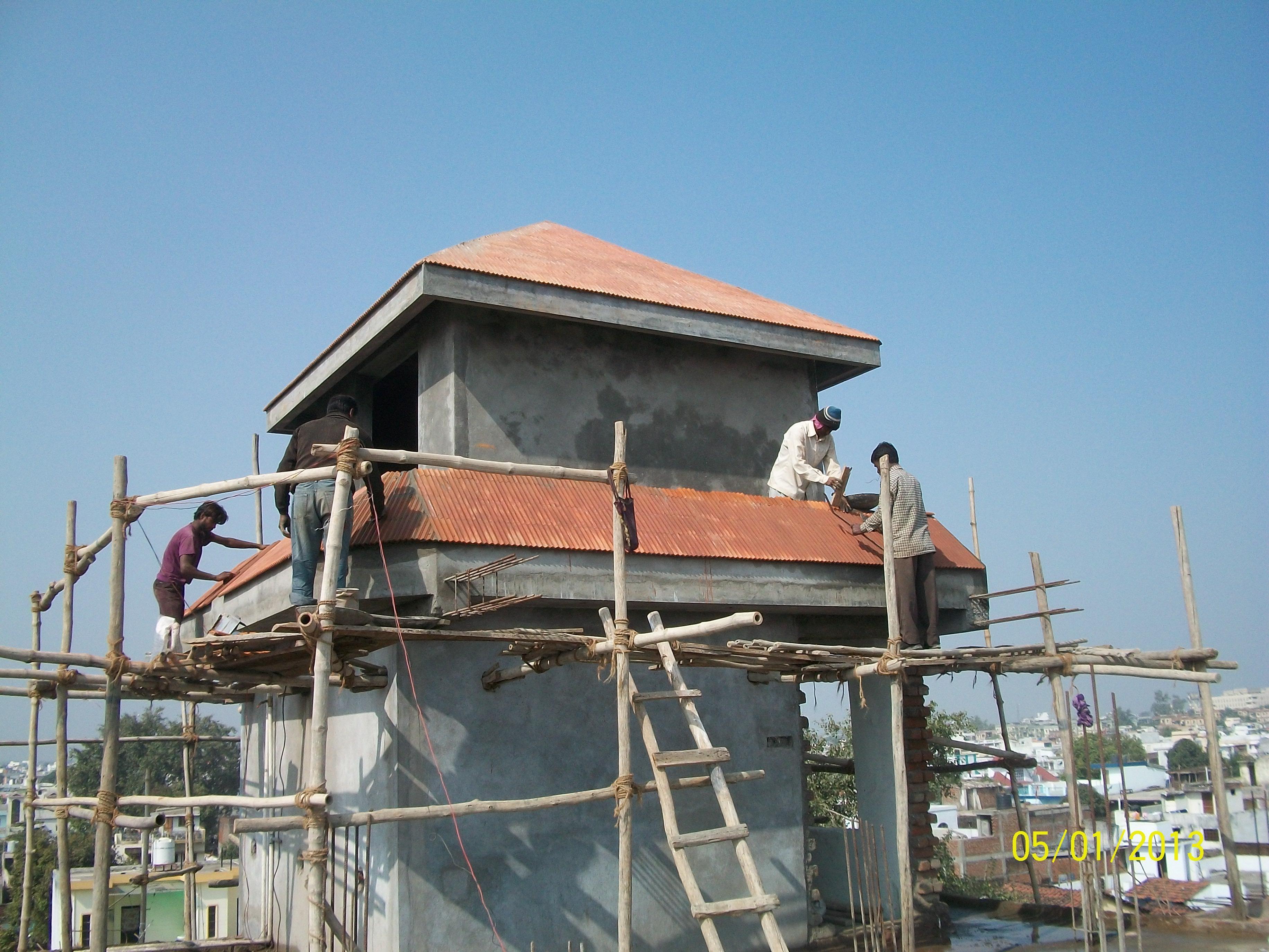 Roof tiles fixing  men at work
