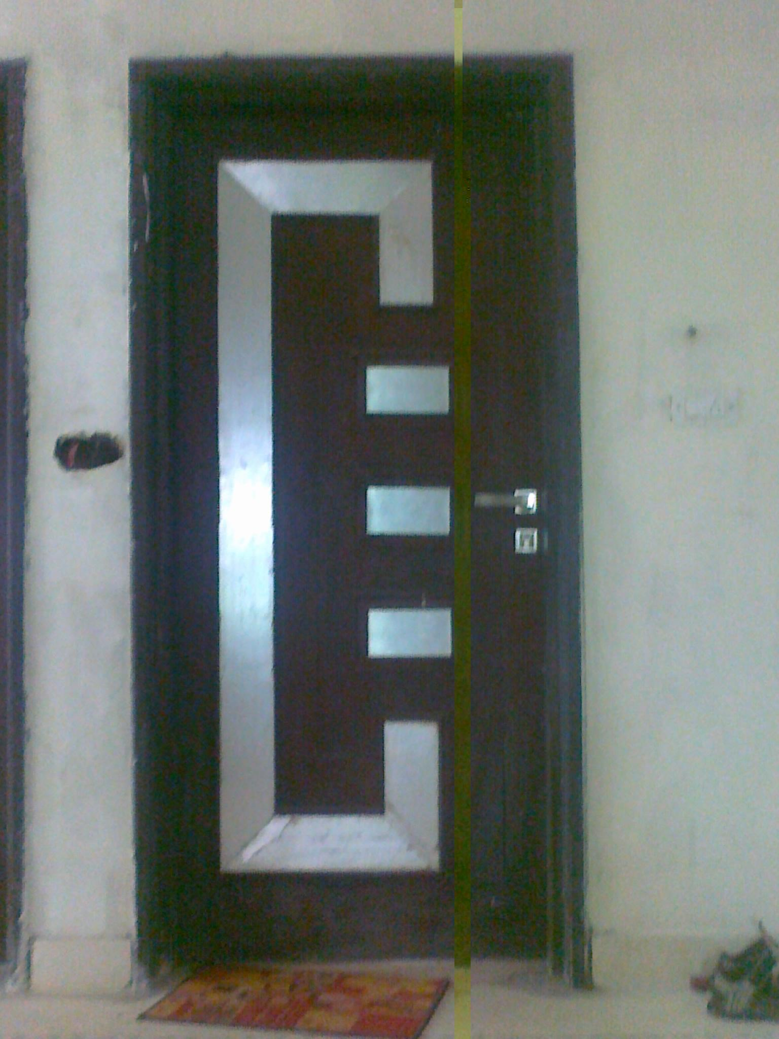 Door design gharexpert for Modern single door designs for houses