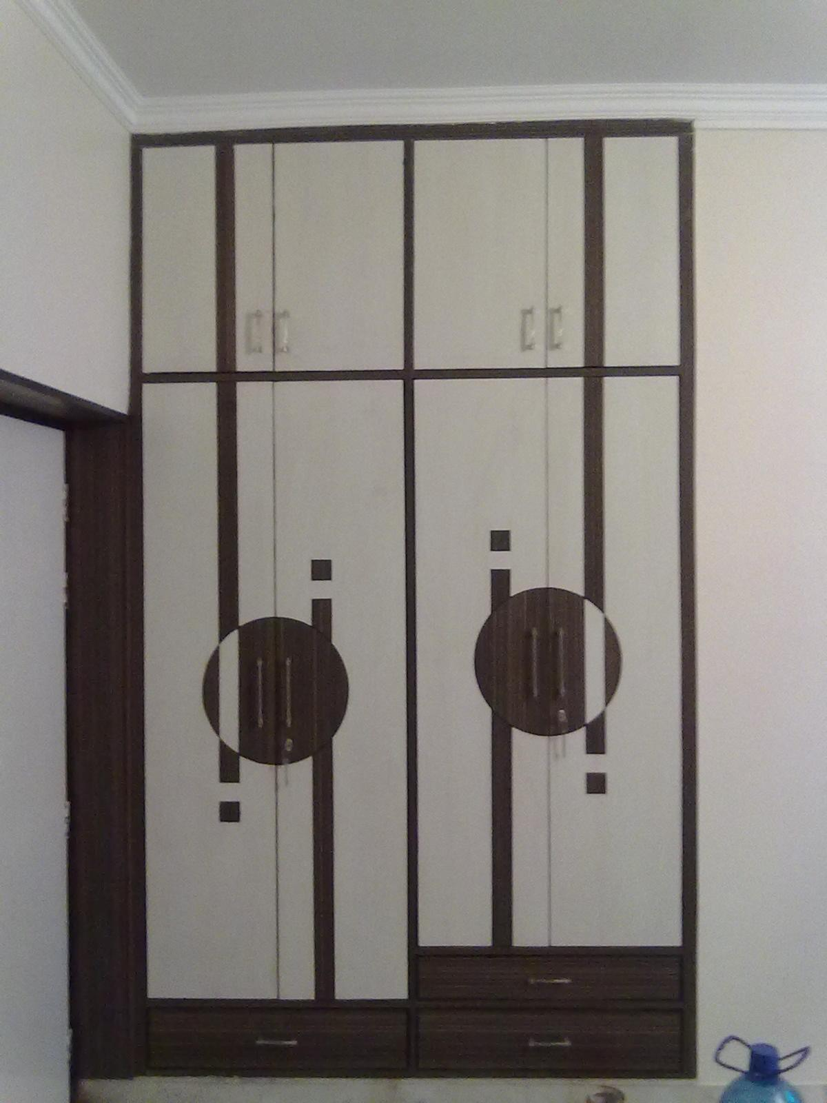 Wardrobe design gharexpert for Bedroom cabinet designs india