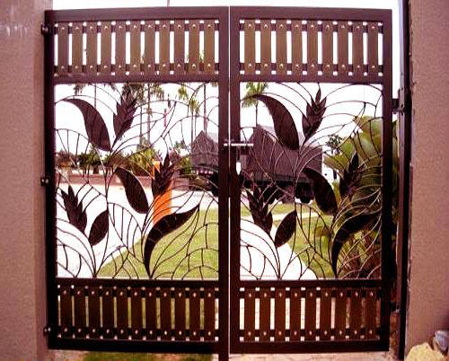 Carved Main gate design in iro....