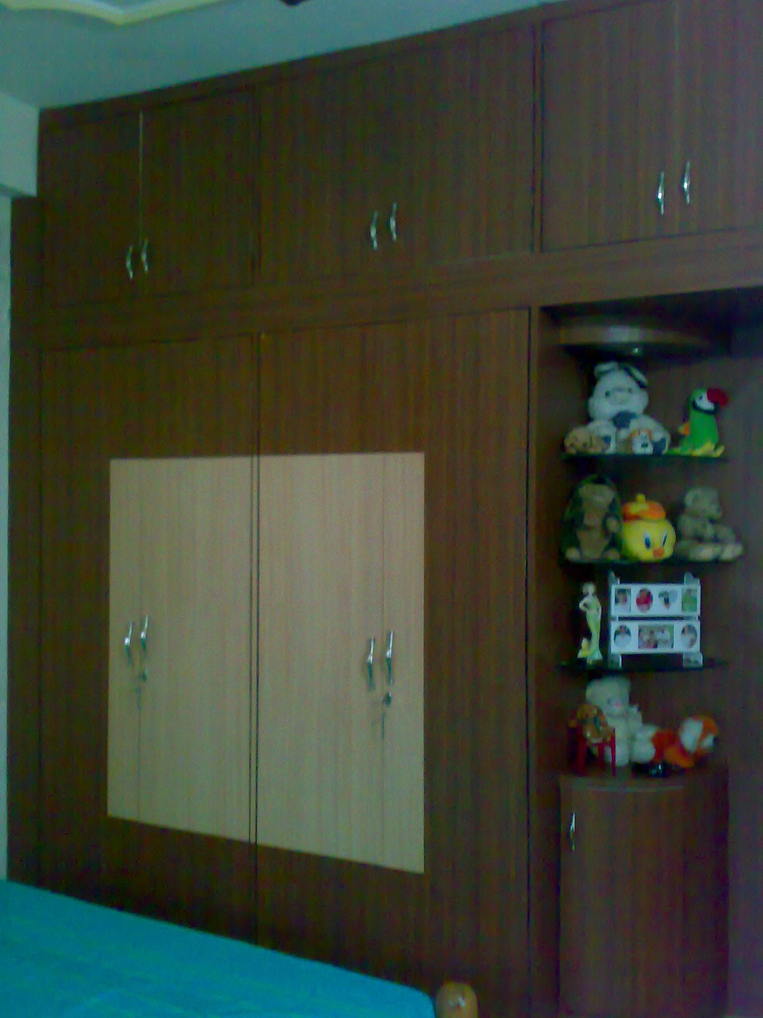 Bedroom wardrobe design gharexpert for Designs for bedroom cupboards