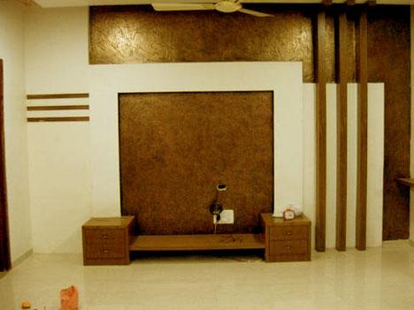 lcd unit in wood combined with textured paint in the back to reduce