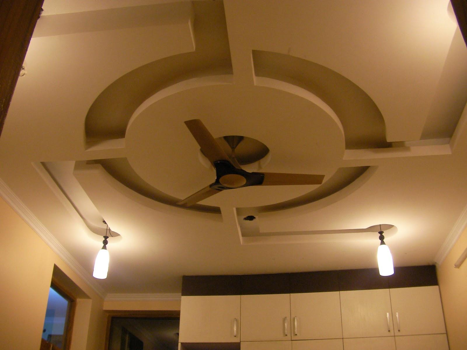 P o p ceiling design with a round design in the center for P o p indian home designs