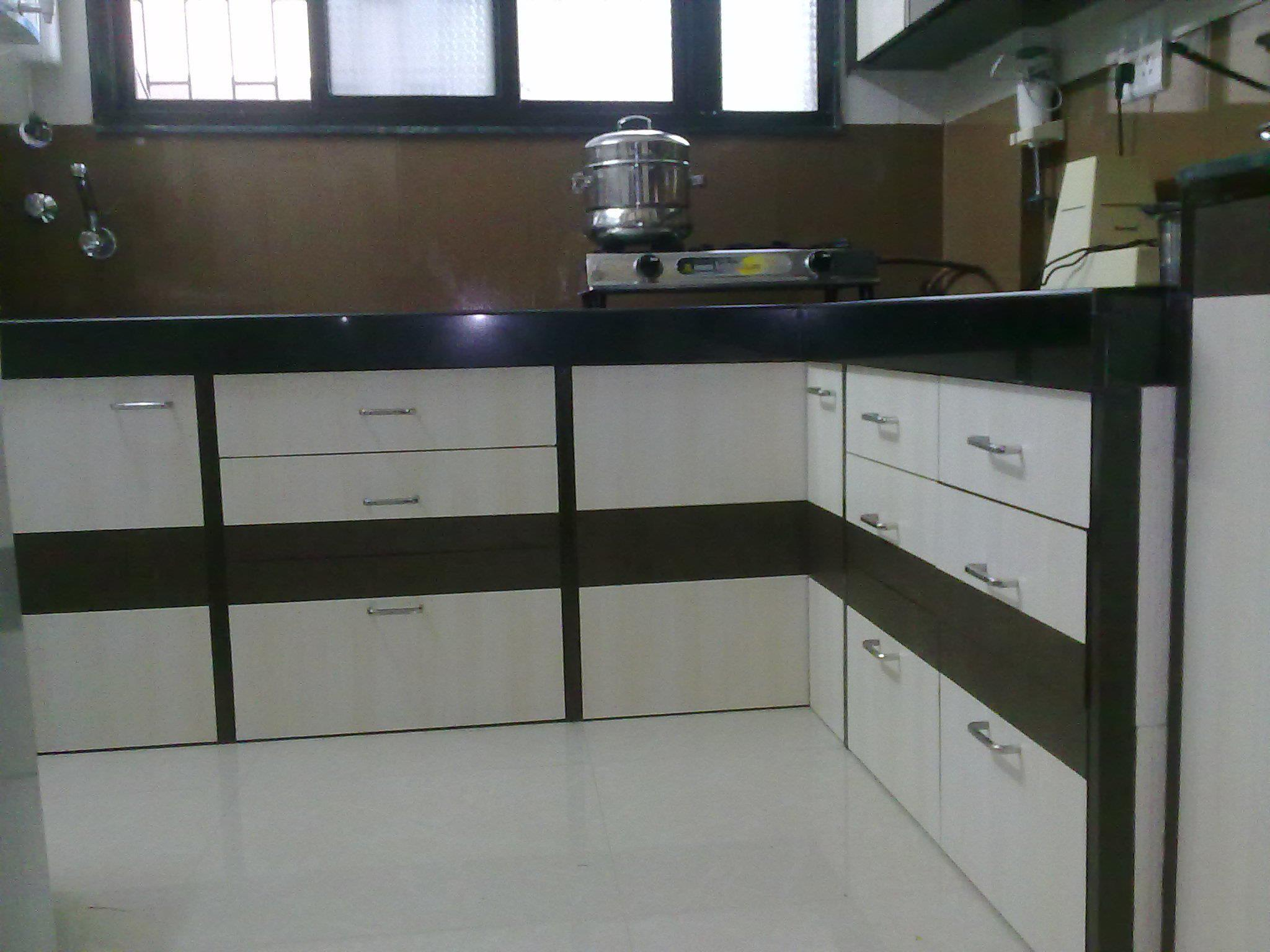 Kitchen cupboard design in laminates gharexpert for Kitchen cupboard designs