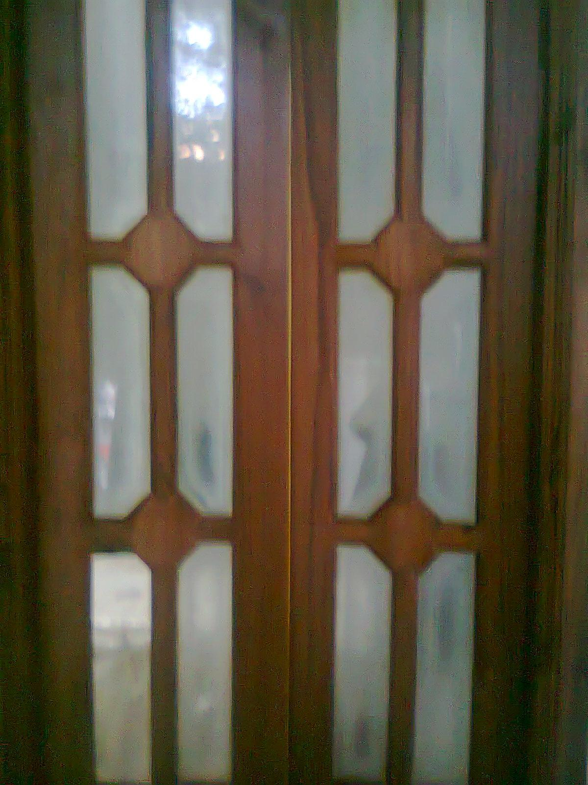 Teakwood main door designs joy studio design gallery for Window design sri lanka