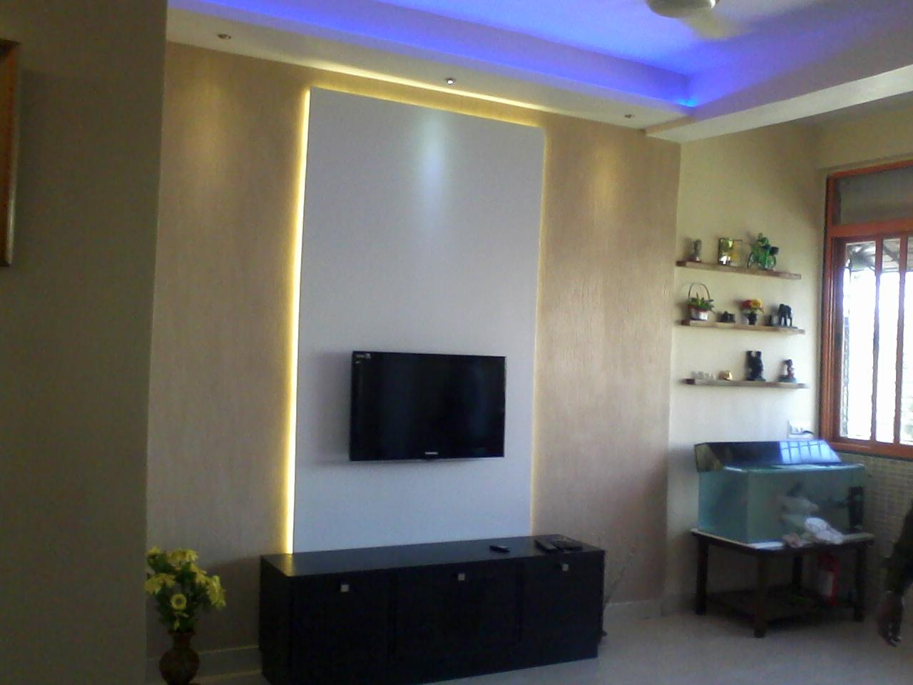 Backlit TV panel with white laminates backlit glow with yellow lights ...