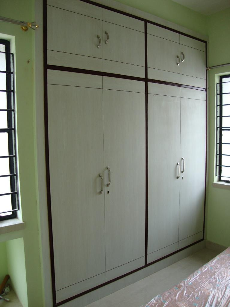 Plain simple wardrobe design gharexpert Simple bedroom wardrobe designs