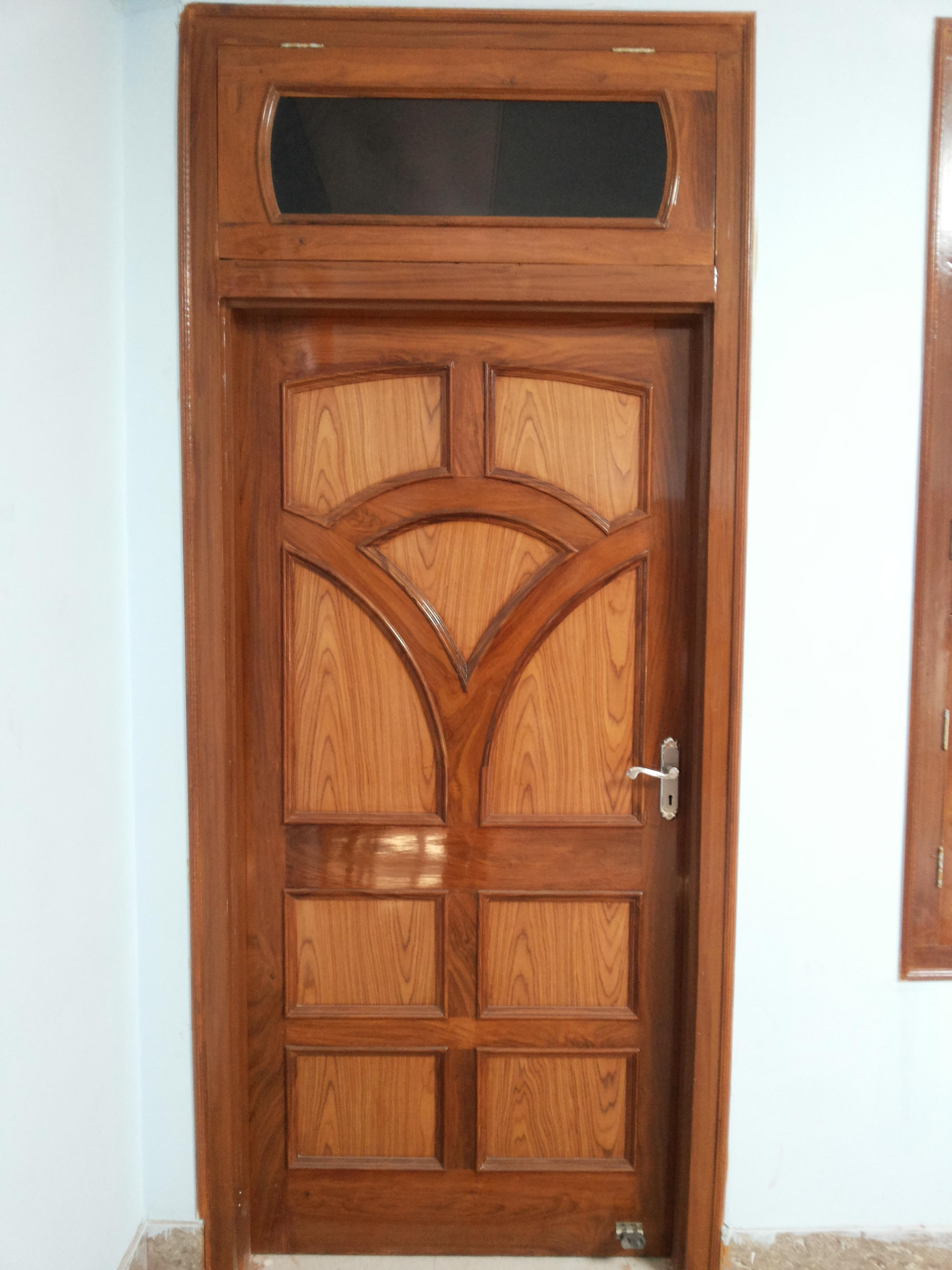 Single panel interior wood door design gharexpert for Door design in wood images