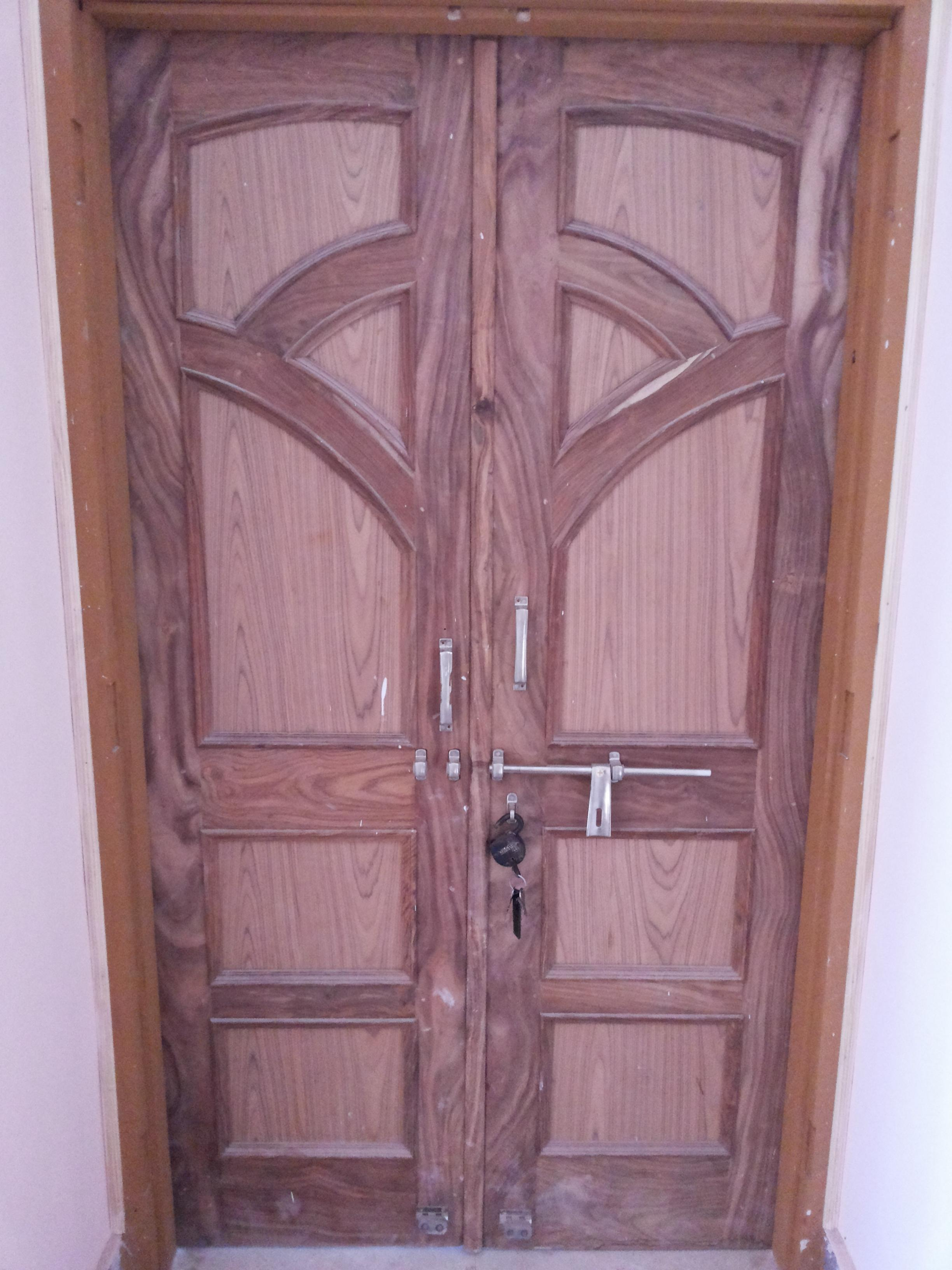 Wood door design with two panels gharexpert for Main two door designs