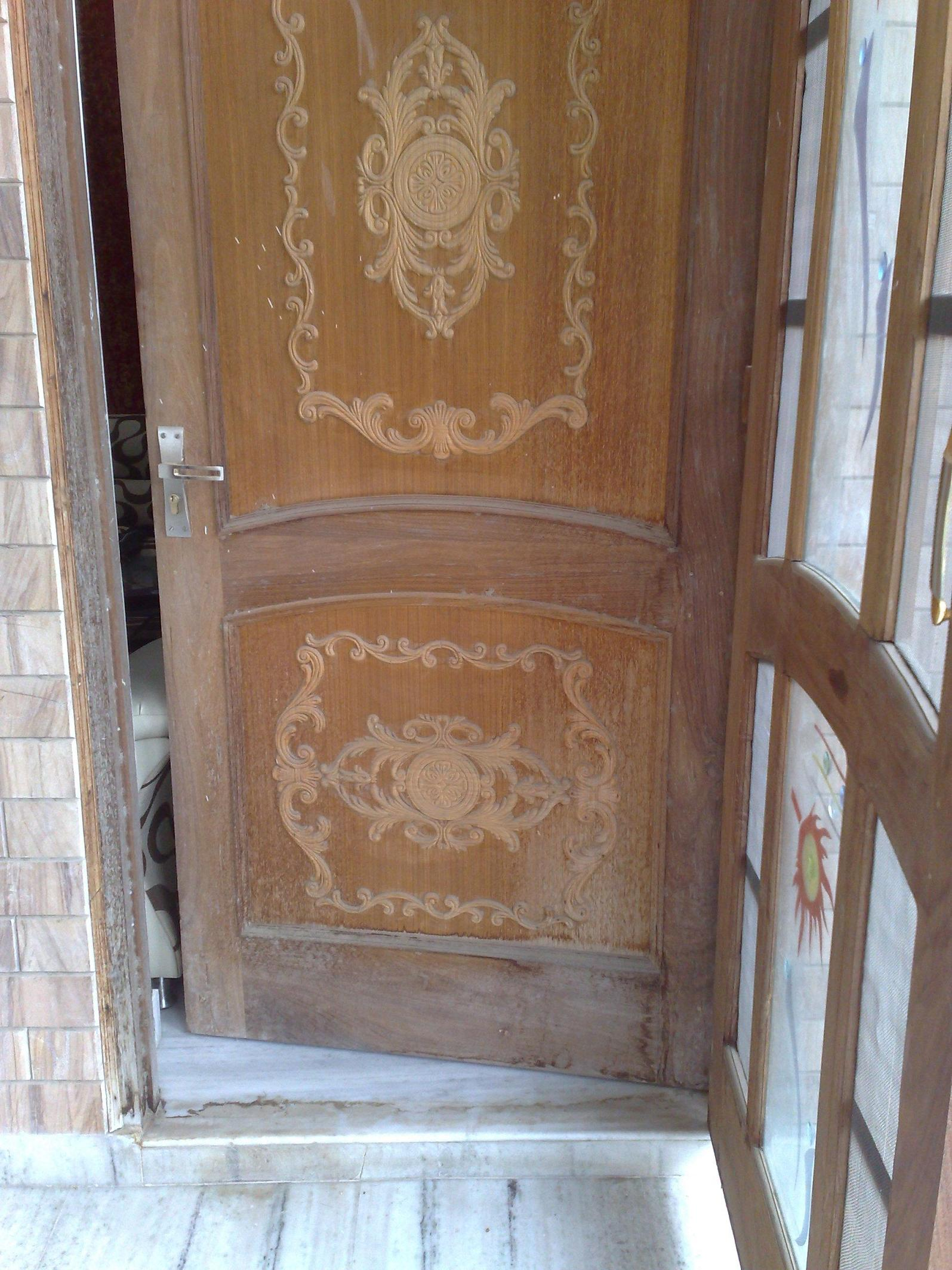 Single wooden door design gharexpert for Single main door designs for home