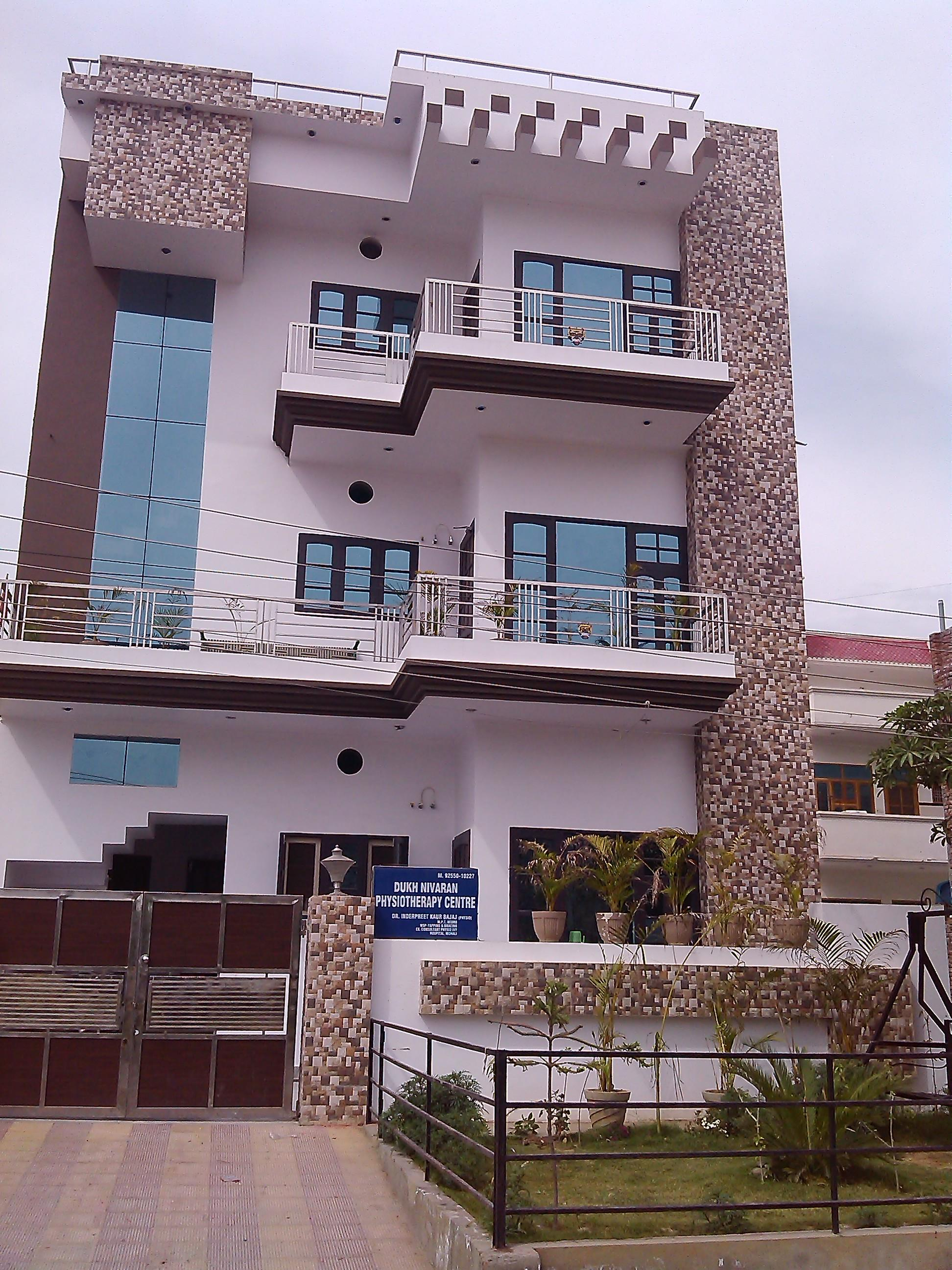 A beautiful front house elevation design with tile for Exterior wall tiles design india