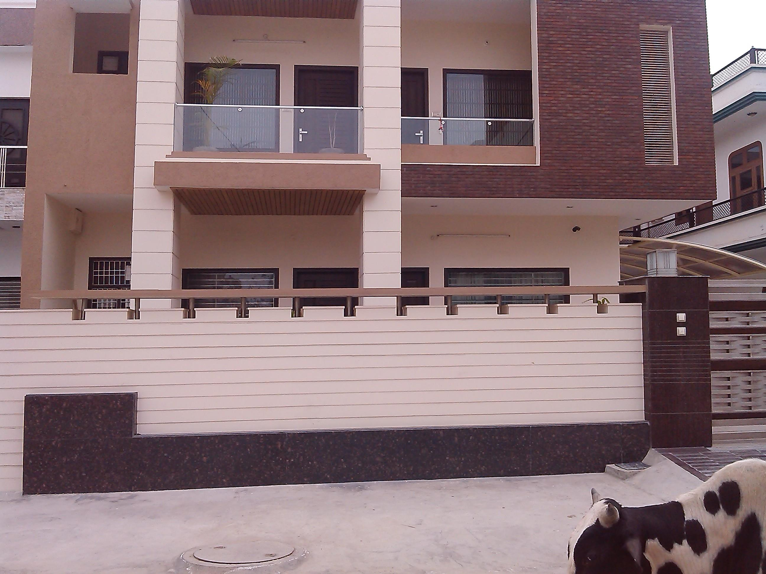 Front Elevation Wall Design : Front house boundary walls with grooves gharexpert