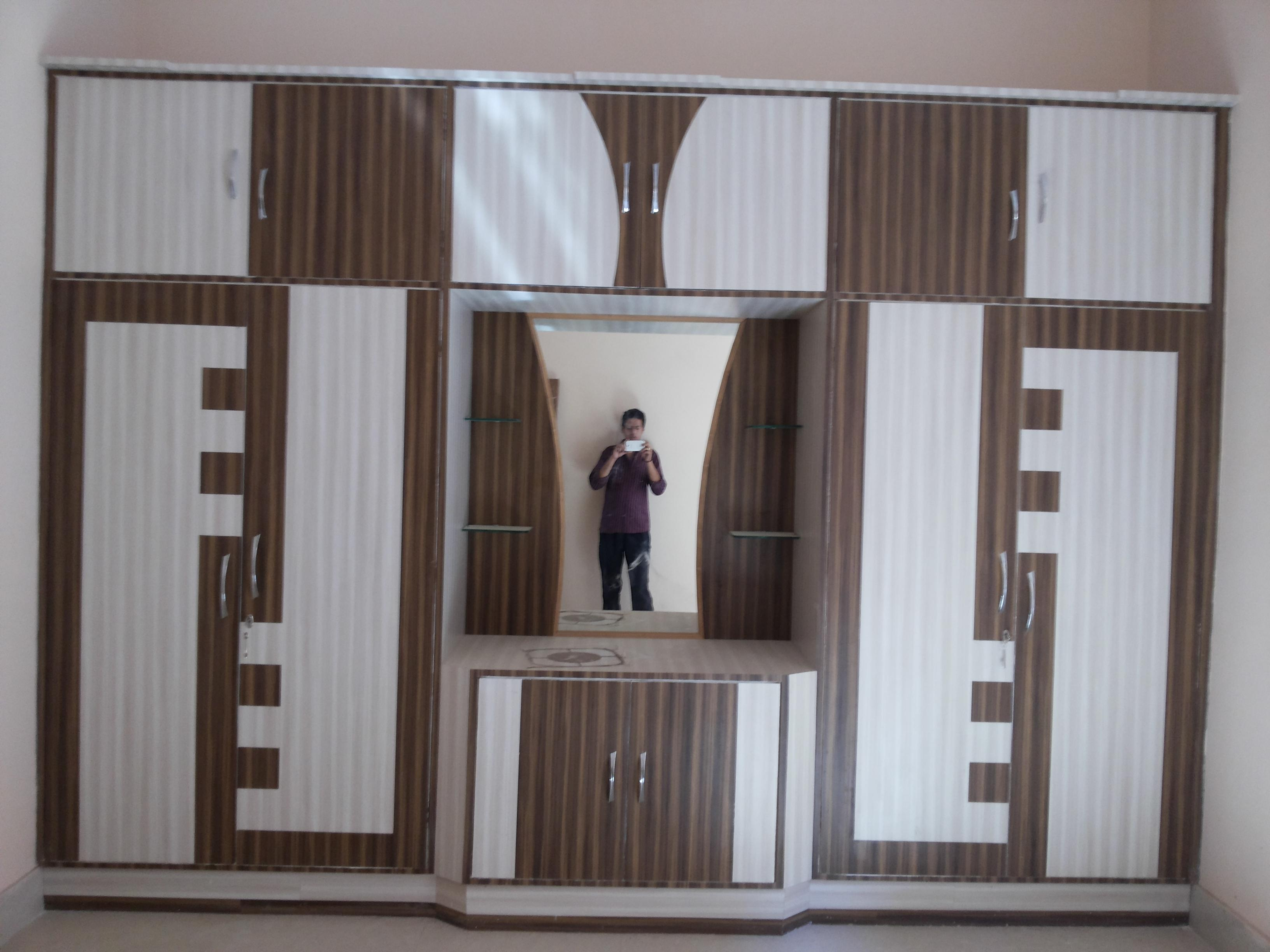 Wardrobe designs for bedroom using laminates gharexpert for Wardrobe designs for small bedroom