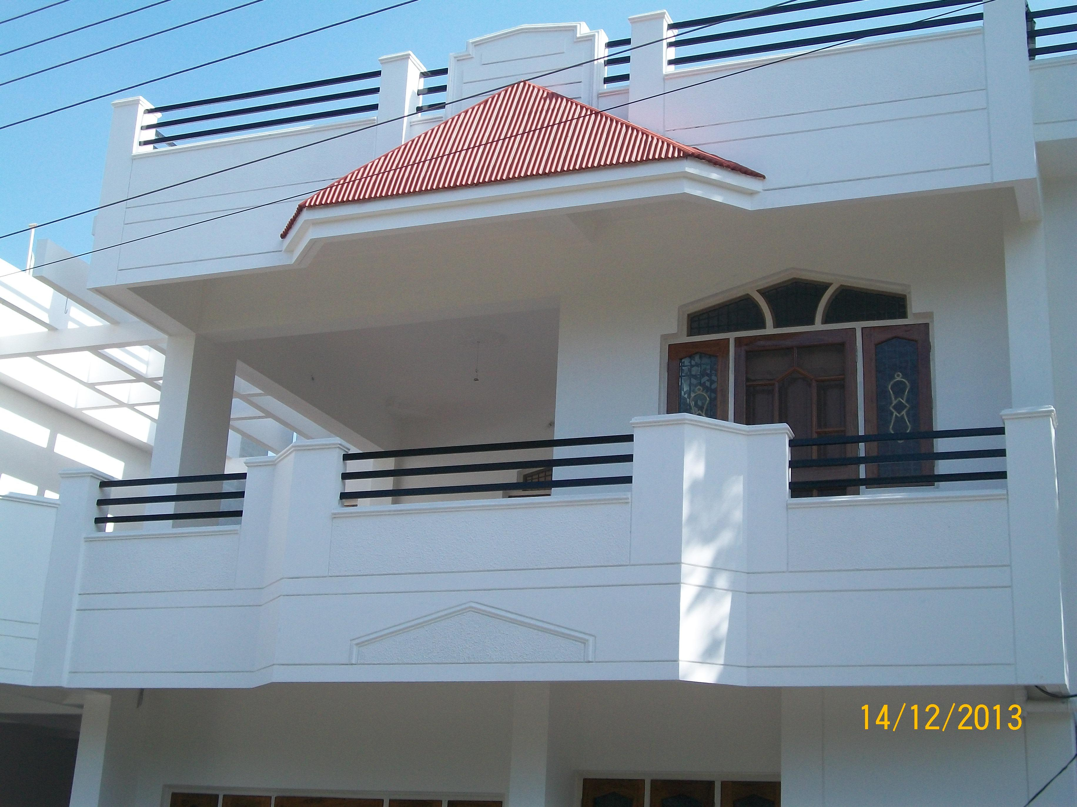 Front Elevation Balcony Design : A duplex house balcony with sloped roof wooden door