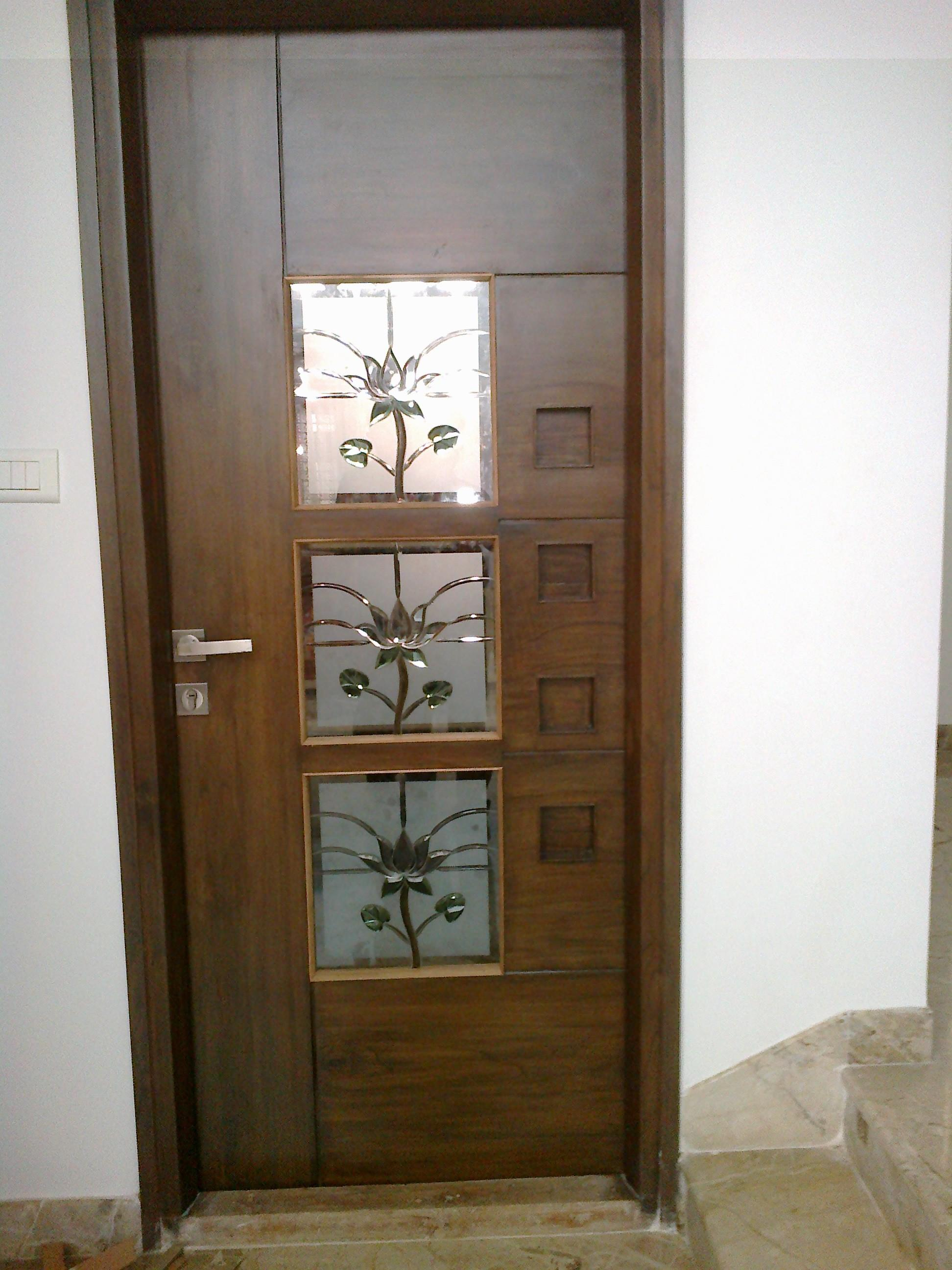 Teak wood pooja room door designs joy studio design for Designer door design
