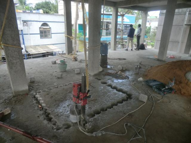 Concrete roof slab cutting usi....
