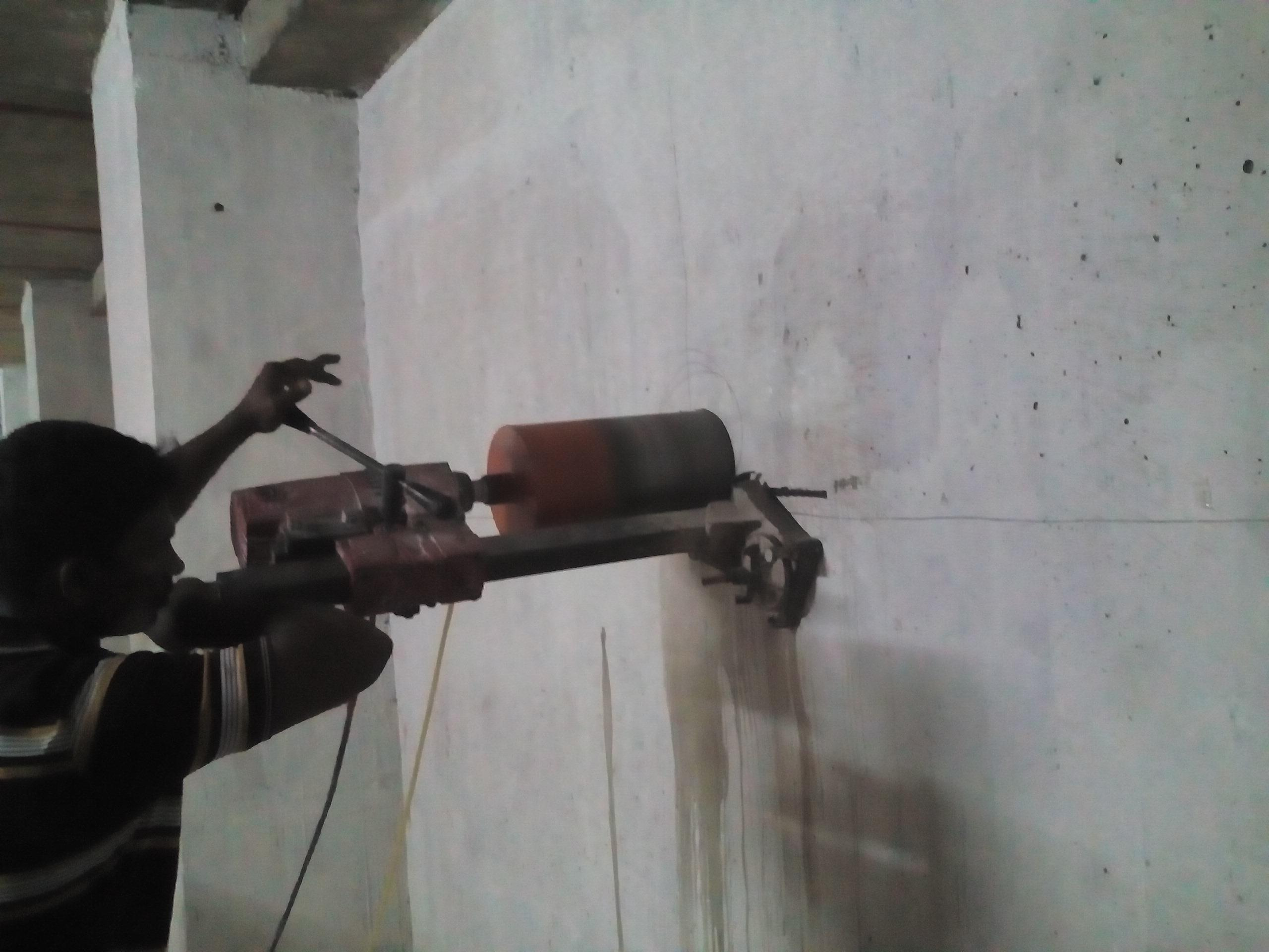 Concrete Wall Cutter : Concrete wall cutting work using diamond saw core