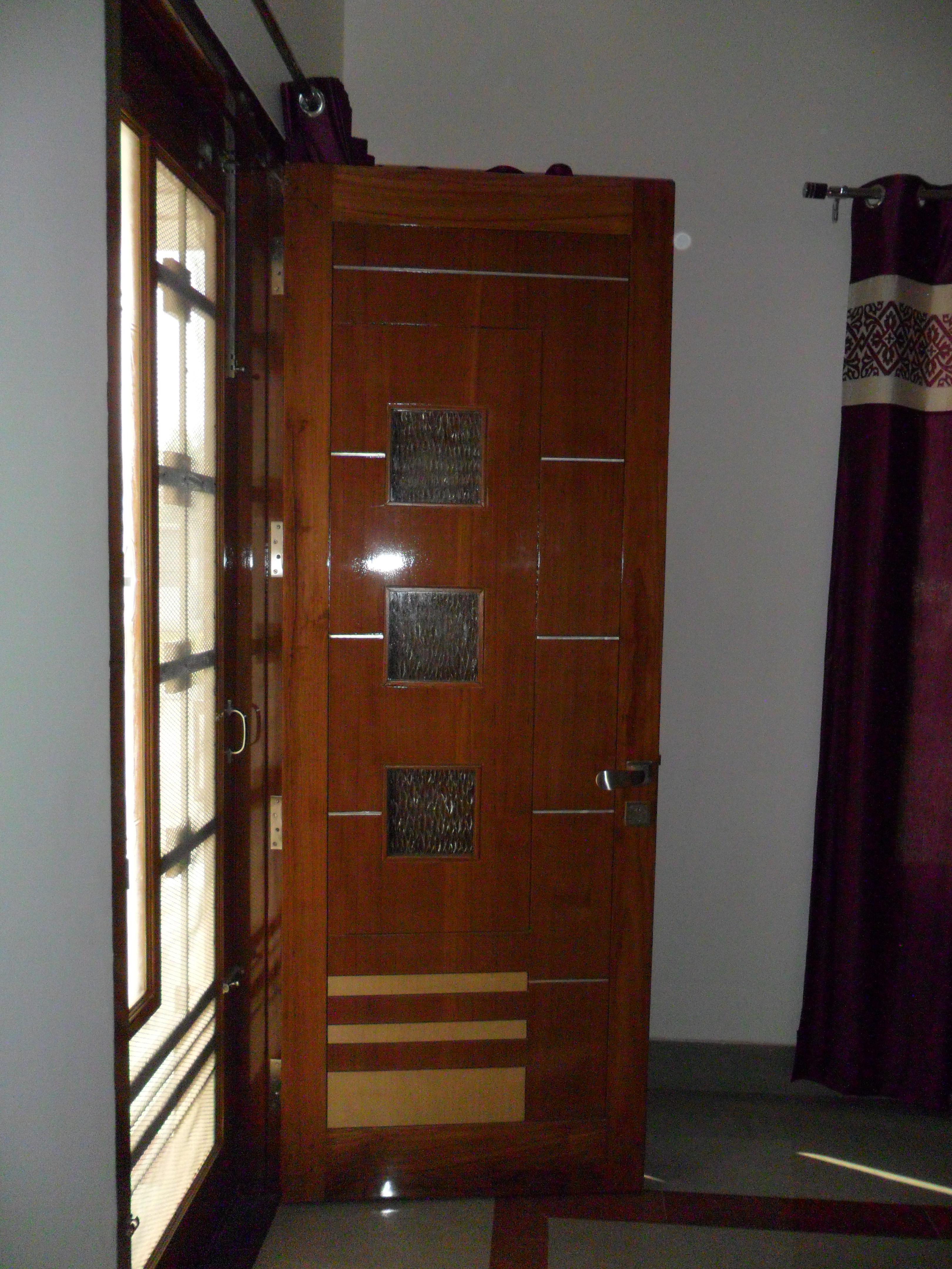 Flush door in teak