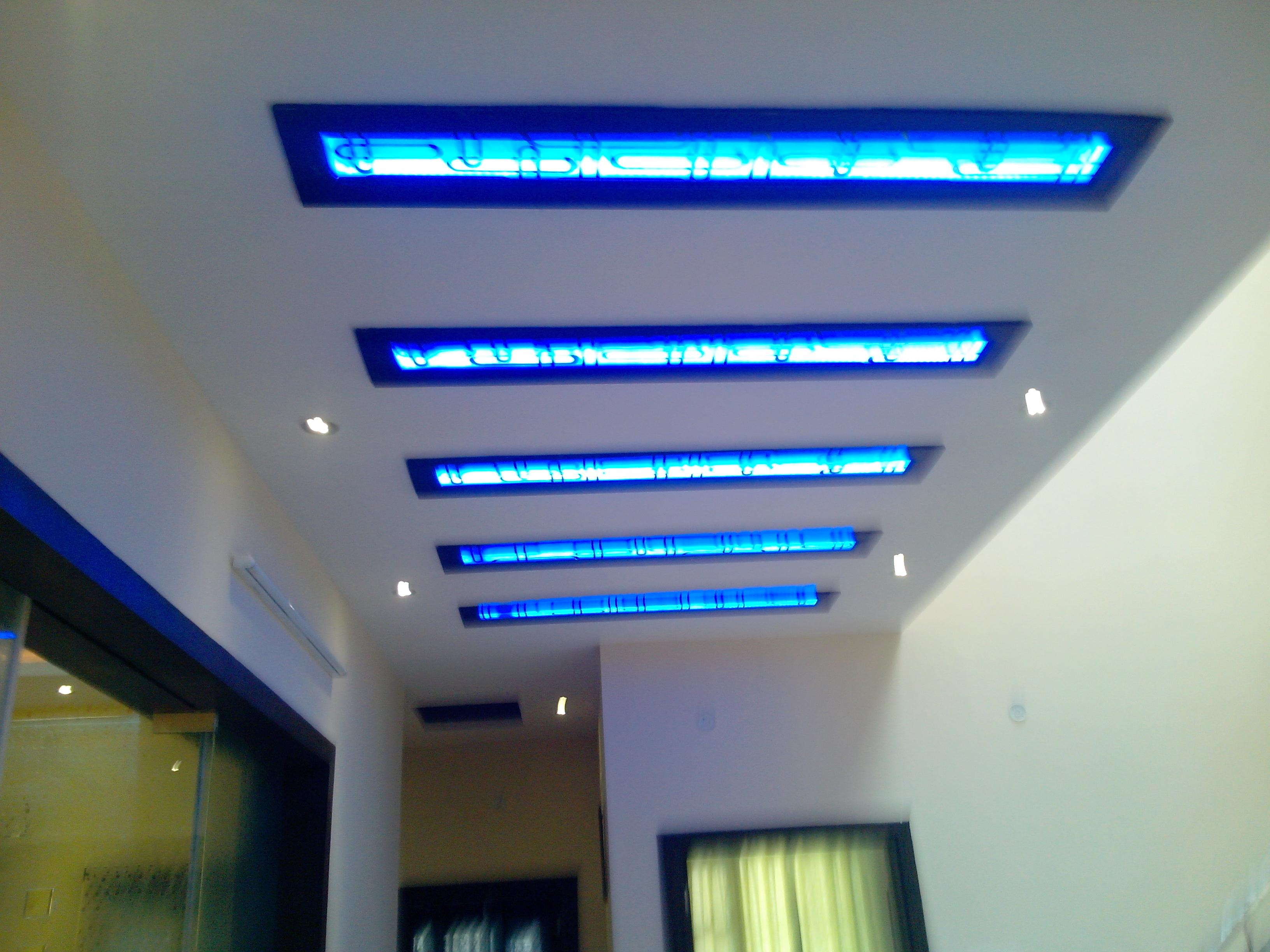 Ceiling design for a lobby area with blue cove lights for False ceiling design for lobby