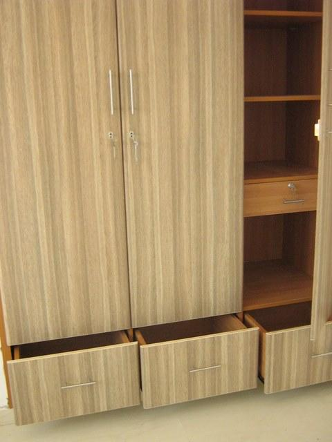 Wardrobe with bottom drawers