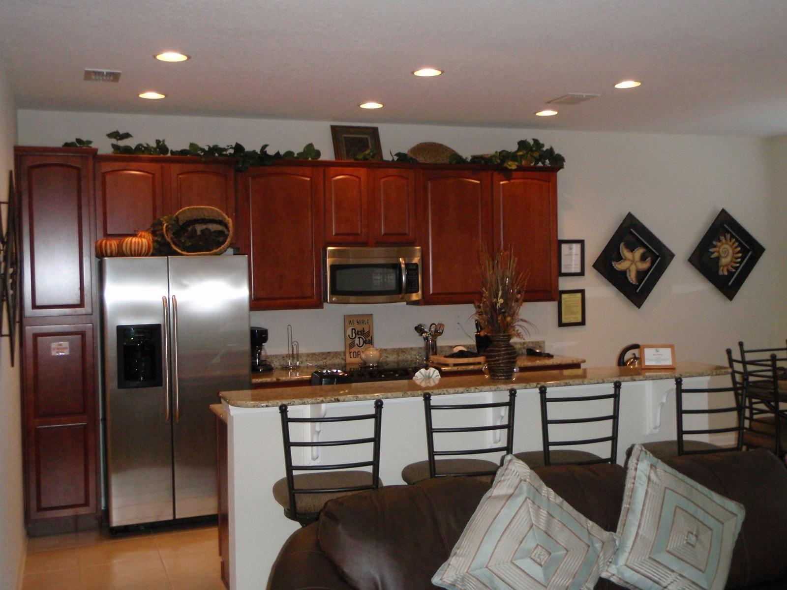 Barstools over the kitchen isl....