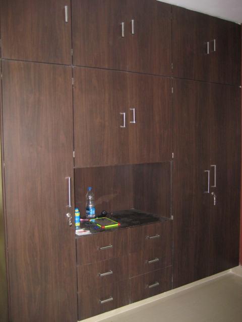 Wardrobe gharexpert for Decolam designs for living room