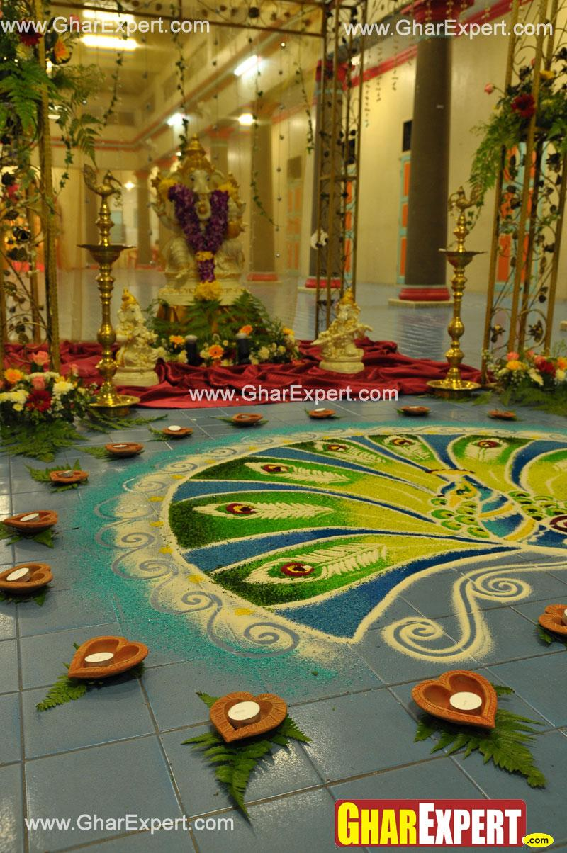 ... rangoli with diyas arrangement on ganesh chaturthi - GharExpert