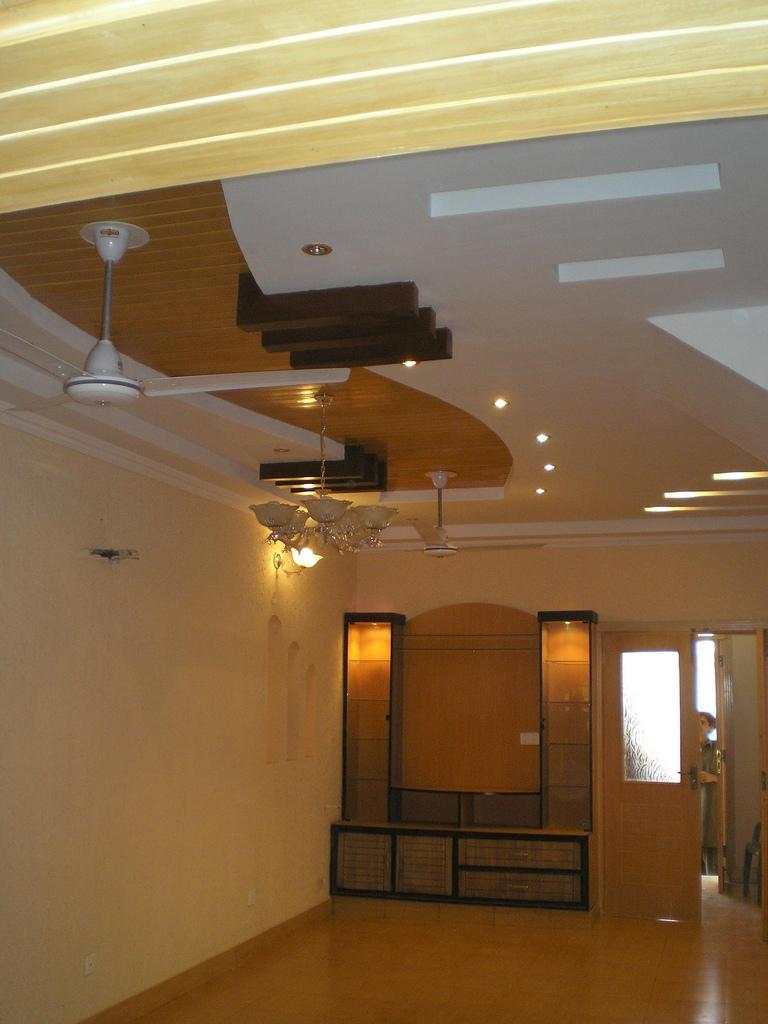 Indian wooden box bed designs - Wooden Ceiling Design With Ceiling Fan Gharexpert