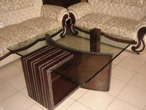 Wooden and glass center table ....