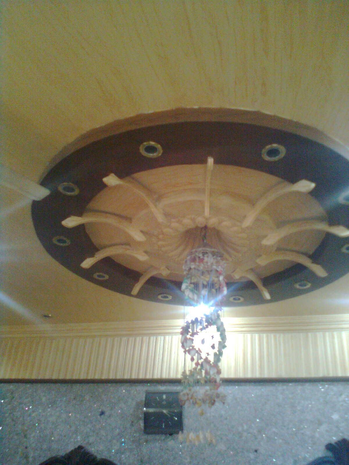 False Ceiling Design With Round Around The Chandelier