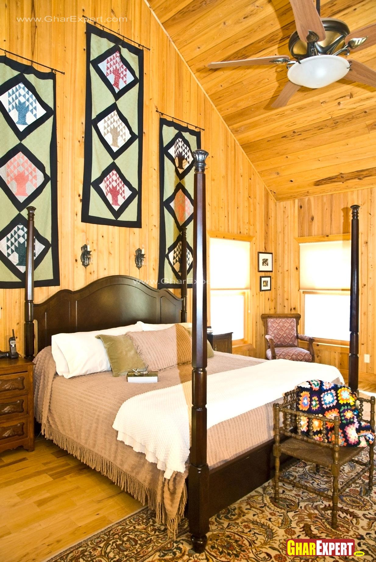 Bedroom with wooden walls and ....