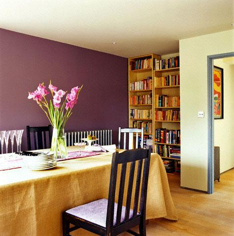 wine colored paint on the wall simple wooden bookcase