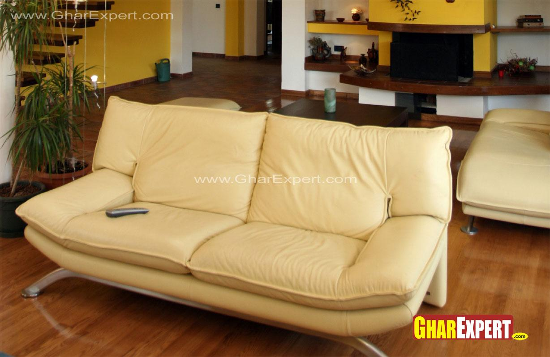 Beige colored 2 seater sofa fo....