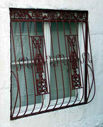 What are various designs of grills in windows?