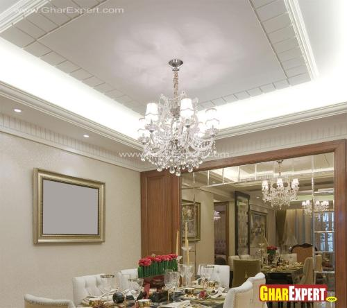 dining room ceiling design accompanied with crystal chandelier