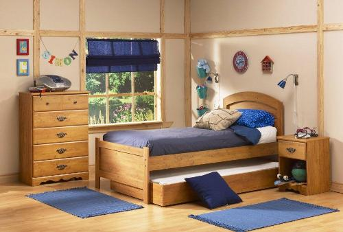 Wooden bed with extra bedding in teen bedroom