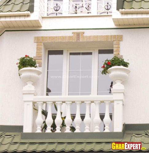 French Balcony with planters in railing posts