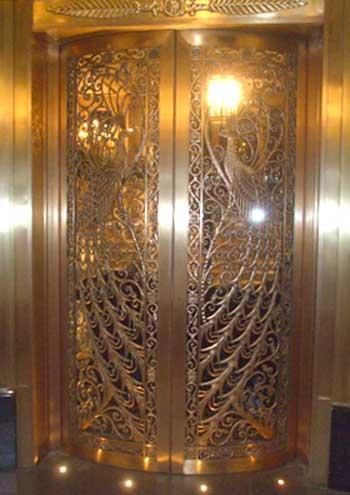 Peacok design in Brass Door and lighing in the floor & Brass Doors - GharExpert.com