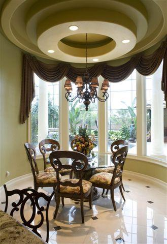 Dome Design In Ceiling With Round Dining Table