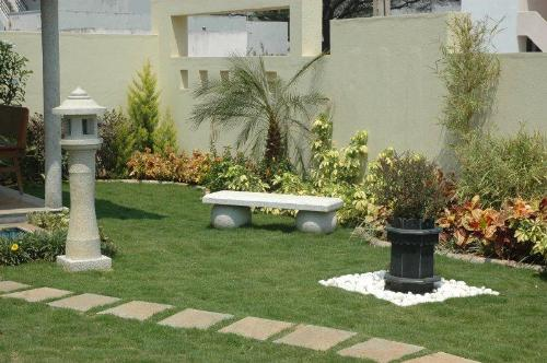 Landscaping Ideas Garage Area : Small garden demands plant selection on the basis of size