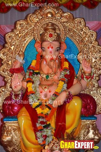 Bright coloured Ganpati decoration with garlands