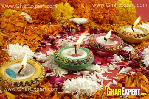 Use colorful diyas and flowers on Diwali for home decoration
