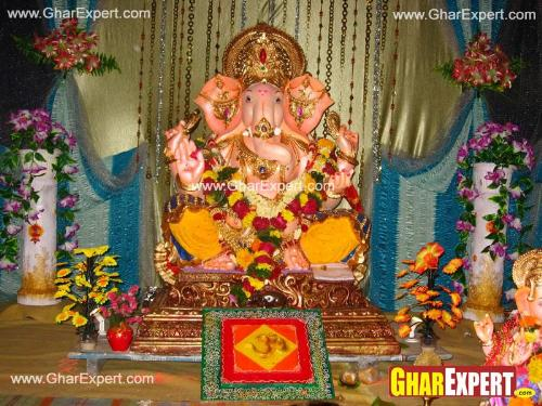 Ganpati decoration with colored cloth pieces and decorating string curtains