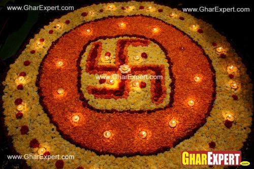 Flower arrangement representing swastik with diyas on diwali